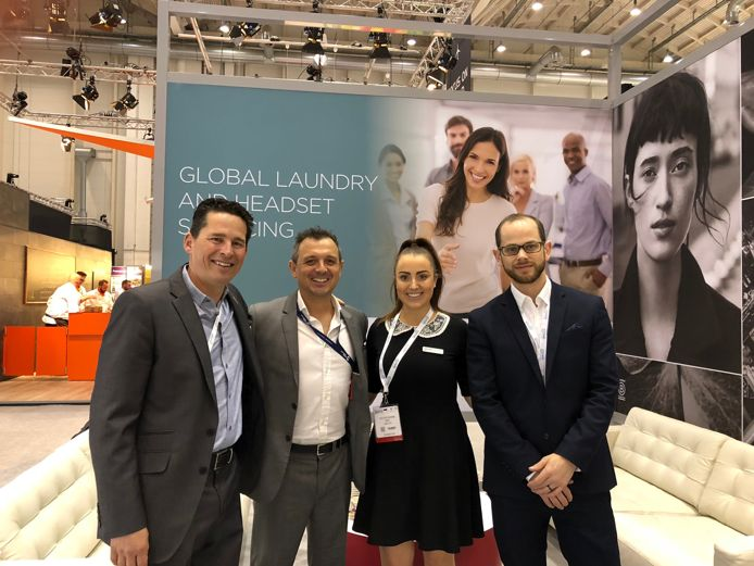 Image of MNH Management Team at WTCE Hamburg 2018 to promote MNH's Global Airline Laundry and Headset Servicing